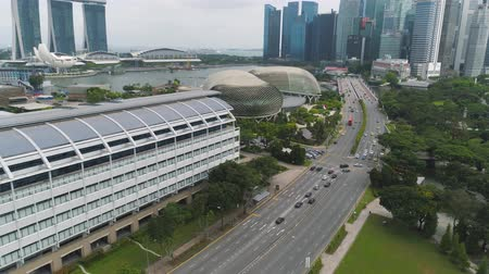 Singapore - 25 September 2018: Singapore city skyline along Singapore River, beautiful green grass and the road. Shot. Aerial for Singapore coastal skyline, high rise buildings and green park. Stock Footage
