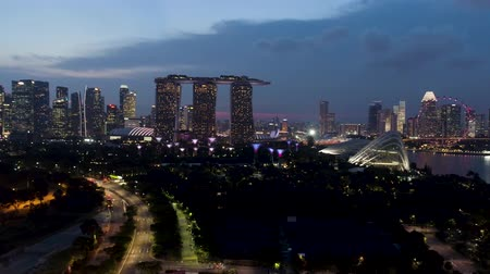Singapore - 25 September 2018: Singapore skyline and river at night with famous Marina Bay sands, Ferris wheel and other city buildings. Shot. Landscape of Singapore business building around Marina Bay. Stock Footage