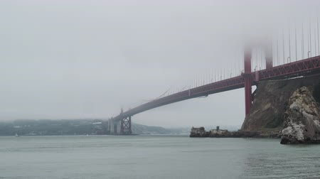 A view of San Francisco Bay, Golden Gate Bridge, and Fort Point on foggy, overcast day