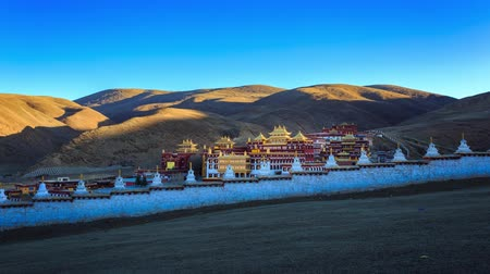 tybet : Timelapse of Chinese temple or tibet style with Landscape View light and shadow at Litang Monastery in the winter season and landmarks public place Sichuan, China at morning twilight