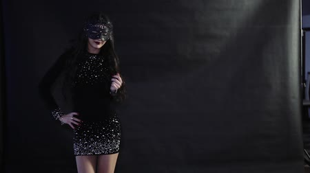 calcinhas : The girl in the mask dances on a black background