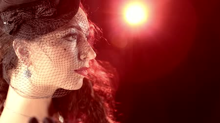 шляпа : Delicate lady in hat burlesque style against a red spotlight