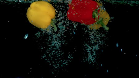 temperos : Three peppers in slow motion in the water HD