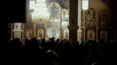 arquipélago : Many people pray in the church Stock Footage