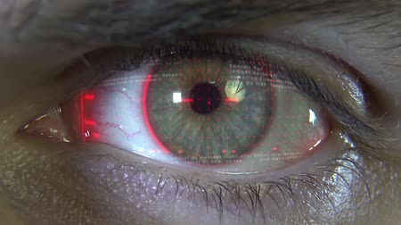 soczewki kontaktowe : Close-up eye with red hologram