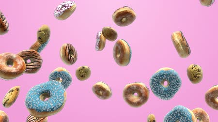 buzlu : Different donuts on a pink background