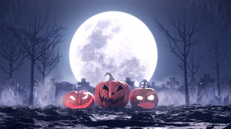 kutlama : Halloween pumpkins on the background of the cemetery and the moon