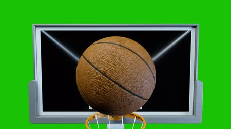 free throw : Basketball hit the basket in slow motion on a green background