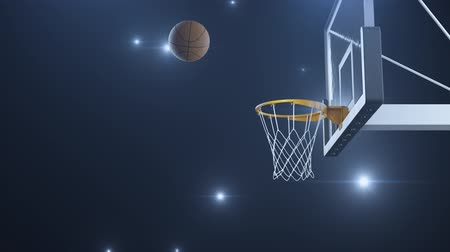free throw : Basketball hit the basket in slow motion on the background of flashes of cameras Stock Footage