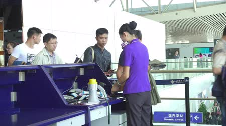 multa : Xi an, China - Sep 22, 2015. Passengers at Check In Counter in Airport before Flight.