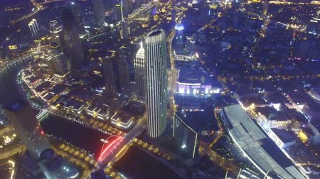 junção : AERIAL shot of Modern buildings and urban cityscape at night,Tianjin,China Vídeos
