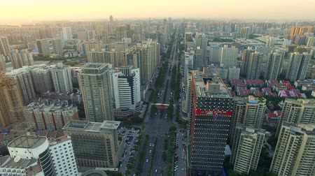 xian : AERIAL shot of traffic moving on road and cityscape at sunset,Xian,China