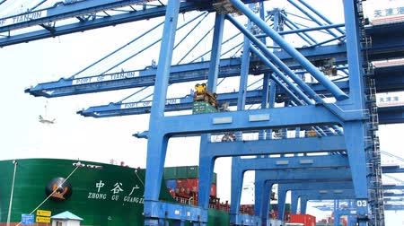 unload : Tianjin,China,Jul 04 2017-Shipping cargo to harbor by crane,tianjin,china.