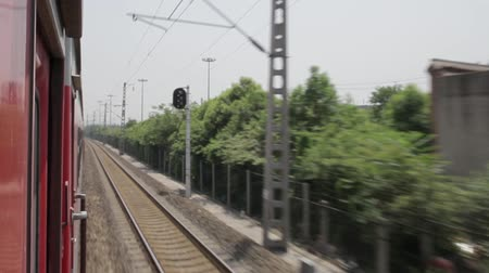 electric : A train moves along railroad tracks ,xian, shaanxi, china