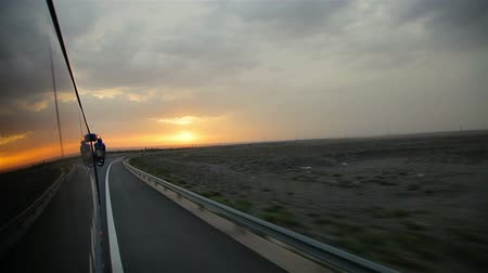 diminishing : Bus runs on the highway at sunset,China.
