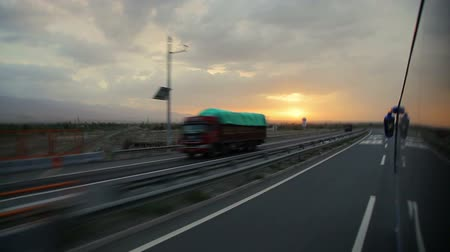 уменьшающийся : Bus runs on the highway at sunset,China.