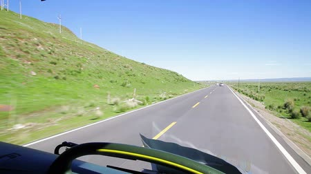 rota : Driving a bus on a country road,Qinghai,China. Vídeos