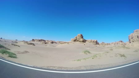 rota : View of car driving in Yardang Landform Gansu, China. Vídeos