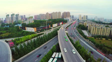пересечение : AERIAL shot of traffic moving on overpasses,Xian,China.