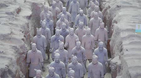 heykelcik : XIAN, CHINA - 17 Jul 2013:  terracotta army warriors and soldiers found outside Xian China Stok Video