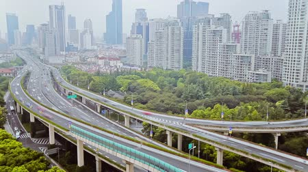 otoyol : Timelapse of busy traffic over overpass in modern city , Shanghai, China