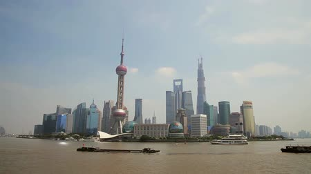 pearl : Shanghai china-Sep 10 2013: Timelapse of Boats crosses the Huangpu River in Shanghai, China.