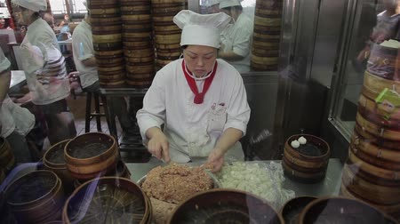 bamboo basket : Shanghai, China - Sep 11, 2013: video of Chefs making Shanghai dumplings, also called xiaolongbao