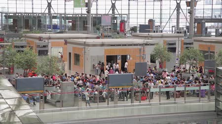 busy line : Shanghai, China - Sep 11, 2013:People travel at Shanghai Hongqiao train station in Shanghai China Stock Footage
