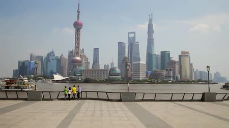 huangpu river : SHANGHAI - Sep 10, 2013: people stay at bund, admire scenic view of buildings at opposite side.