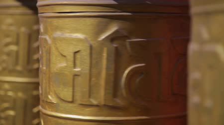 tybet : golden prayer wheels in temple,China Wideo