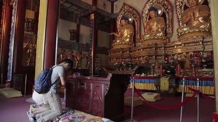 chapel : XIAN CHINA - MAY 27 2012: Buddhists pray inside the Temple