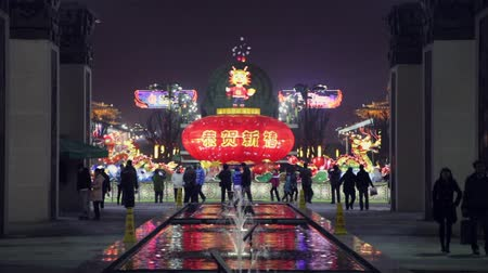 lenda : XIAN CHINA-Feb 03 2012: Lanterns decorations and people roaming during chinese spring festival