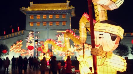 shaanxi : Tourists view lantern decorations at the City  Wall during  Lantern Festival,xian,shaanxi,china