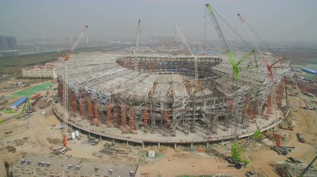 construction crane : XIAN, CHINA - MARCH 25, 2019: AERIAL shot of stadium being built,China