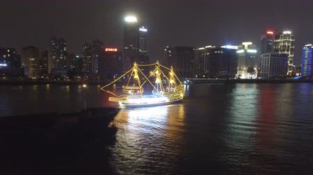torre : AERIAL shot of tour boats traverse Shanghais scenic Huangpu River at dusk,China Stock Footage