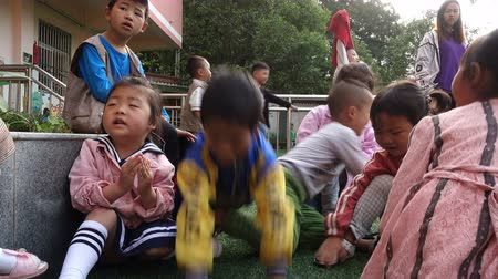 schoolyard : Guangyuan, CHINA - JUNE 04, 2019: Children playing on playground,China.