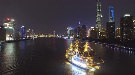 traverse : AERIAL shot of tour boats traverse Shanghais scenic Huangpu River at dusk,China Stock Footage