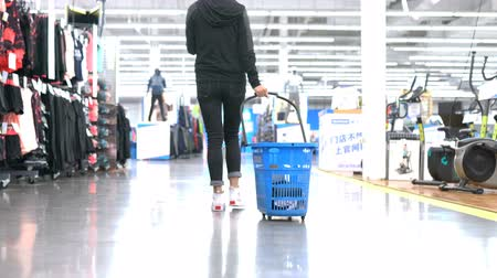 legs only : woman shopping in a clothing store Stock Footage
