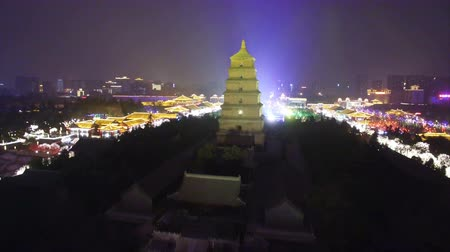 xian : AERIAL View of Big Wild Goose Pagoda scenic spot and city skyline at night ,Xian, Shaanxi, China