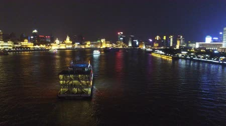 cbd : AERIAL shot of tour boats traverse Shanghais scenic Huangpu River at dusk,China Stock Footage