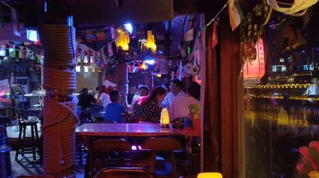 dyskoteka : Fenghuang, Hunan, China, JULY 29, 2019. View of inside the bar in Fenghuang Ancient Town at night.