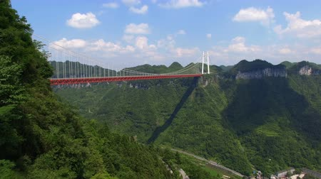 water feature : Aerial view of Aizhai suspension bridge on canyon,Hubei,China. Stock Footage