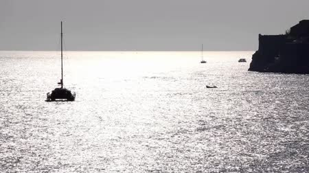 catamaran : Anchored sailboat with lowered the sail. Shot near Dubrovnik old town. Stock Footage