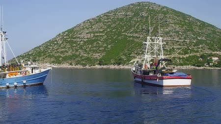 Средиземное море : Typical Mediterranean fishing boat in the sea near coast preparing for fishing. Location Peljesac peninsula, Croatia