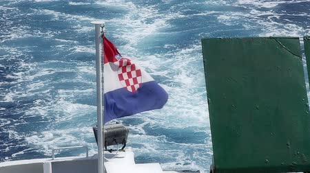 hırvat : Croatian flag on a back of the ferry boat.