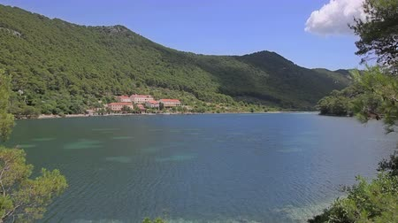 obec : Small village in the canal at the entrance of the national park Mljet, Croatia.