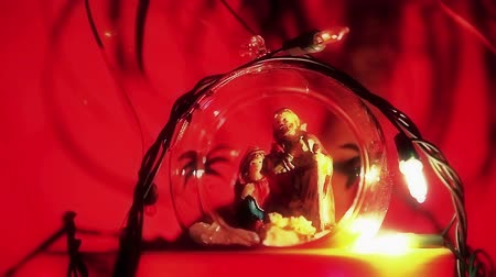 Христос : Nativity scene in a Christmas ball with lights - shallow depth of field. Bethlehem with Jesus Christ, Mother Mary and Joseph