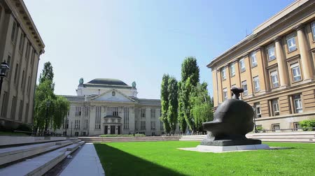 poeta : ZAGREB, CROATIA - May 5: Panoramic view to the square named after Croatian national poet Marko Marulic with a Croatian National Archive building in background on May 5, 2012 in Zagreb, Croatia.