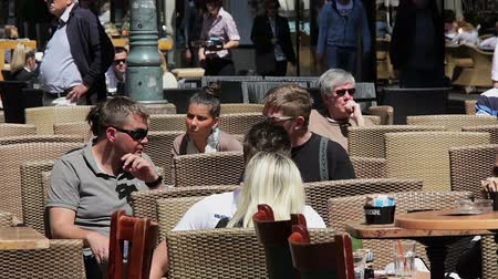 caffe : ZAGREB, CROATIA - May 5: People drinking coffee at outdoor terrace in Bogoviceva street in the city center on May 5, 2012 in Zagreb, Croatia. For Zagreb citizens drinking coffee is a lifestyle.