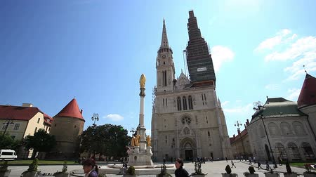 reconstructed : ZAGREB, CROATIA - May 5: People and tourist walking around The Cathedral of Assumption of the Blessed Virgin Mary on May 5, 2012 in Zagreb, Croatia. It is the tallest sacral building in Croatia.